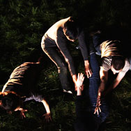 Four dancers laying in the grass