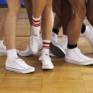 Group of dancers' legs with converse sneakers on